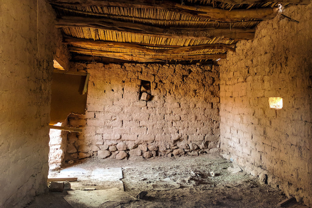 An empty room of a reconstructed ghost town in the Atacama Desert