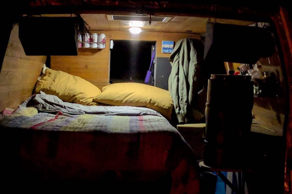 View into the back of a camper van at night