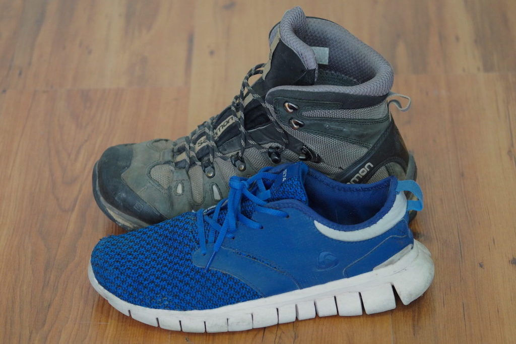 A side by side size comparison between the Salomon Quest 4D 3 GTX boot and a Tesla travel shoe