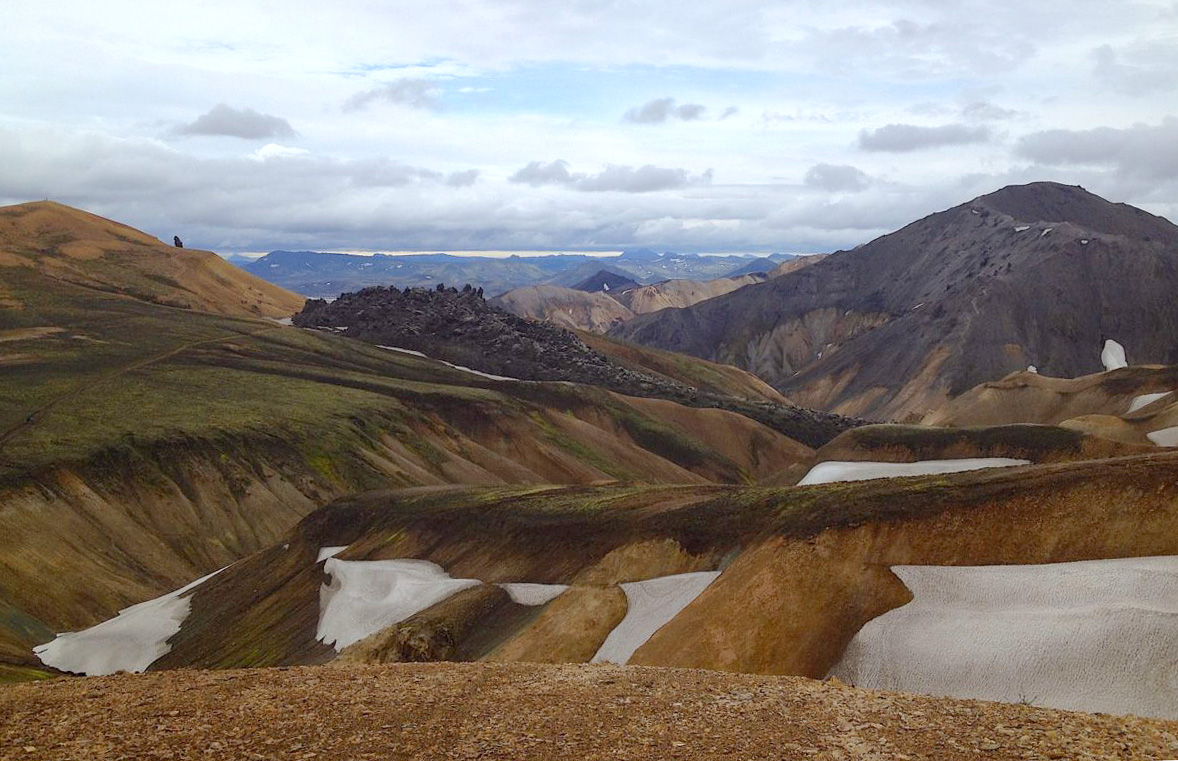 Landscape view of rolling hills and mountains on the Laugavegurinn Trek in Iceland