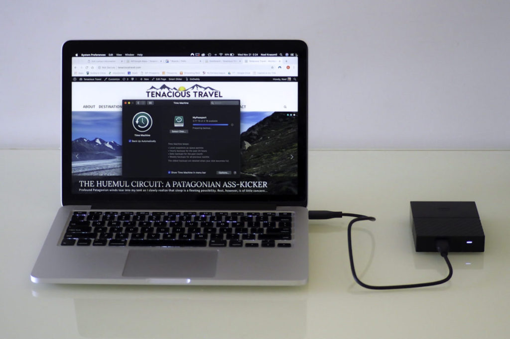A Macbook Pro getting its data backed up to a 4 TB WD Passport external hard drive
