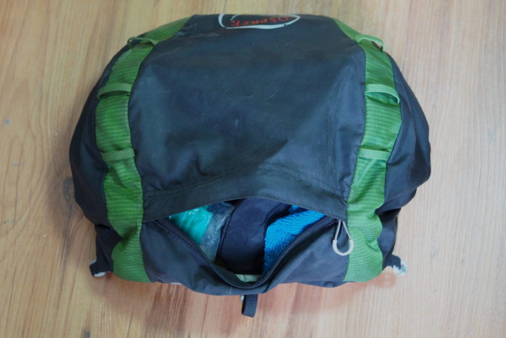 A top view of the open lid of the Osprey Exos 48 backpack