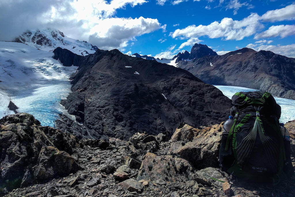 Osprey Exos 48 Backpack perched in front of a snowy mountain range near El Chalten, Argentina