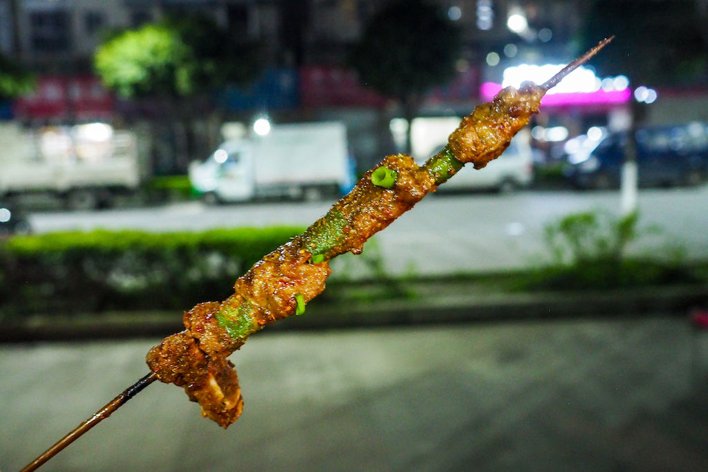 A skewered of grilled beef generously coated in spices